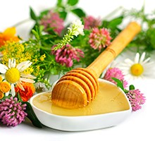 flowers and honey on a white background